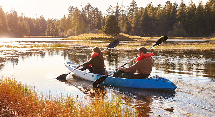 Big Bear camping: Couple kayaking on lake